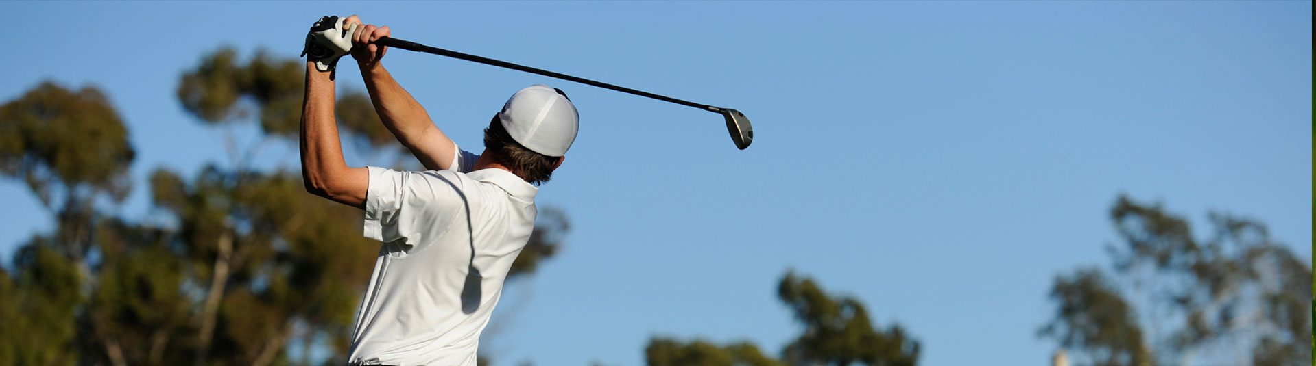 A golfer swings his club
